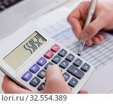 Купить «Finance analyst looking and financial reports», фото № 32554389, снято 2 марта 2017 г. (c) Elnur / Фотобанк Лори