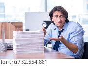 Купить «Young employee unhappy with excessive work», фото № 32554881, снято 29 апреля 2019 г. (c) Elnur / Фотобанк Лори