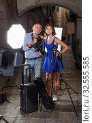 Купить «girl and professional photographer during photo shoot», фото № 32555585, снято 5 октября 2018 г. (c) Яков Филимонов / Фотобанк Лори