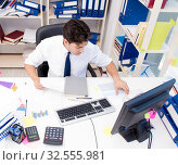 Купить «Businessman working in the office with piles of books and papers», фото № 32555981, снято 3 августа 2017 г. (c) Elnur / Фотобанк Лори