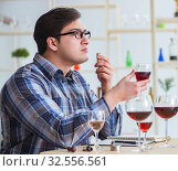 Купить «Professional sommelier tasting red wine», фото № 32556561, снято 31 марта 2017 г. (c) Elnur / Фотобанк Лори