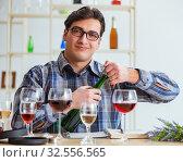 Купить «Professional sommelier tasting red wine», фото № 32556565, снято 31 марта 2017 г. (c) Elnur / Фотобанк Лори