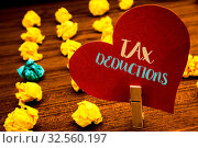 Купить «Text sign showing Tax Deductions. Conceptual photo Reduction on taxes Investment Savings Money Returns Text red heart wood clip desk crumbled paper notes yellow blue love message», фото № 32560197, снято 5 августа 2020 г. (c) easy Fotostock / Фотобанк Лори