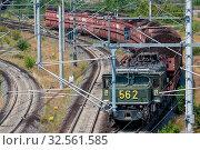 Купить «Hambach lignite mine, Germany - June 28 2018: German train transporting brown coals from Hambach open pit mine to power plant», фото № 32561585, снято 28 июня 2018 г. (c) easy Fotostock / Фотобанк Лори