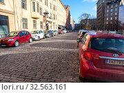 Купить «Paved road is in central parts of city. Typical downtown with low storey houses. Helsinki city, Finland», фото № 32563161, снято 30 октября 2019 г. (c) Кекяляйнен Андрей / Фотобанк Лори