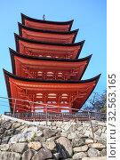 Купить «Building of five-storied Pagoda Gojunoto at Itsukushima. Japan. It was constructed in Japanese style in 1407, and it was restored in 1533. Miyajima the Shrine Island», фото № 32563165, снято 13 апреля 2013 г. (c) Кекяляйнен Андрей / Фотобанк Лори