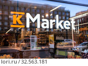 Купить «K-Market grocery store logo is on glass shopwindow. Kesko Food manages the K-food store chains, which are K-Market, K-Supermarket and K-Citymarket», фото № 32563181, снято 30 октября 2019 г. (c) Кекяляйнен Андрей / Фотобанк Лори