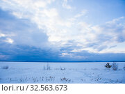 Купить «Sunset over the lake covered with ice», фото № 32563673, снято 19 марта 2016 г. (c) Юрий Бизгаймер / Фотобанк Лори