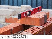 Купить «Construction of  brick building», фото № 32563721, снято 10 августа 2016 г. (c) Юрий Бизгаймер / Фотобанк Лори