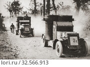 Armoured cars at Biefvillers, France setting out on a reconnaissance during WWI. From The Pageant of the Century, published 1934. Редакционное фото, фотограф Classic Vision / age Fotostock / Фотобанк Лори
