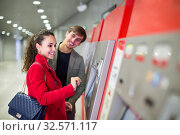 Купить «Passengers buying subway ticket», фото № 32571117, снято 6 декабря 2019 г. (c) Яков Филимонов / Фотобанк Лори