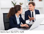 Купить «young man and friendly woman coworkers talking in firm office», фото № 32571129, снято 31 мая 2020 г. (c) Яков Филимонов / Фотобанк Лори