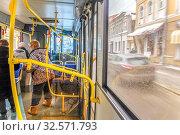 Russia, Samara, February 2017: the conductor works in a public bus, heals passengers. Редакционное фото, фотограф Акиньшин Владимир / Фотобанк Лори