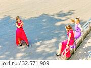 Купить «Russia, Samara, June 2017: smart school graduates take pictures of each other in memory of the Volga River embankment on a sunny summer day.», фото № 32571909, снято 25 мая 2017 г. (c) Акиньшин Владимир / Фотобанк Лори