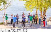 Купить «Russia, Samara, May 2017: a group of older people studying Scandinavian walking on the Volga River Embankment on a summer sunny day.», фото № 32571913, снято 25 мая 2017 г. (c) Акиньшин Владимир / Фотобанк Лори