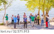 Russia, Samara, May 2017: a group of older people studying Scandinavian walking on the Volga River Embankment on a summer sunny day. Редакционное фото, фотограф Акиньшин Владимир / Фотобанк Лори