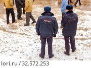 Купить «Russia, Samara, March 2017: Russia, Samara, June 2017: two police officers observe the behavior of citizens at the rally. . The text in Russian: police.», фото № 32572253, снято 19 марта 2017 г. (c) Акиньшин Владимир / Фотобанк Лори