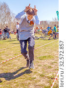 Купить «Russia, Samara, April 2017: children's relay race, together with their parents for the opening of the bike season in the city park on a spring sunny day.», фото № 32572857, снято 29 апреля 2017 г. (c) Акиньшин Владимир / Фотобанк Лори