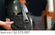 Knights training - a man holding a protective iron helmet. Стоковое видео, видеограф Константин Шишкин / Фотобанк Лори