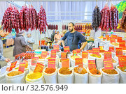 Russia, Samara, April 2017: sale of various spices brought from Abkhazia to the city fair. Text in Russian: hops-suneli, Paprika sweet, Adzhika dry, for shish kebab and other spices. Редакционное фото, фотограф Акиньшин Владимир / Фотобанк Лори