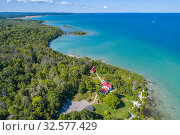 Купить «Grand Traverse Light is a lighthouse in the U. S. state of Michigan, located at the tip of the Leelanau Peninsula, which separates Lake Michigan and Grand...», фото № 32577429, снято 10 августа 2019 г. (c) age Fotostock / Фотобанк Лори