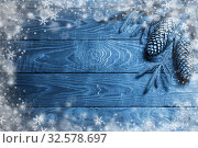 Купить «fir branches and cone on dark old wooden background», фото № 32578697, снято 13 октября 2019 г. (c) Майя Крученкова / Фотобанк Лори
