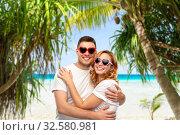 Купить «happy couple in white t-shirts and sunglasses», фото № 32580981, снято 6 октября 2019 г. (c) Syda Productions / Фотобанк Лори