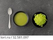 Купить «close up of romanesco broccoli cream soup in bowl», фото № 32581097, снято 12 апреля 2018 г. (c) Syda Productions / Фотобанк Лори