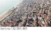 Aerial panoramic view of modern cityscape of Badalona in sunny day, Spain (2019 год). Стоковое видео, видеограф Яков Филимонов / Фотобанк Лори