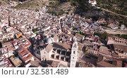 Купить «Aerial panoramic view of Xativa cityscape with Collegiate Basilica of Santa Maria, Spain», видеоролик № 32581489, снято 16 апреля 2019 г. (c) Яков Филимонов / Фотобанк Лори