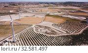 Купить «Aerial view of wind power plants near the town of La Muela, Spain», видеоролик № 32581497, снято 19 февраля 2020 г. (c) Яков Филимонов / Фотобанк Лори