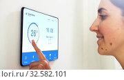 Купить «woman looking at tablet computer at smart home», видеоролик № 32582101, снято 21 января 2020 г. (c) Syda Productions / Фотобанк Лори