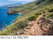Path over Gulf of Castellammare faces the Tyrrhenian Sea in Riserva Naturale Orientata dello Zingaro natural park, the first reserve in Sicily, Italy. Стоковое фото, фотограф Konrad Zelazowski / easy Fotostock / Фотобанк Лори