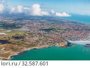 View from a flying plane on the city of Fiumicino and the Tyrrhenian sea, Italy (2017 год). Стоковое фото, фотограф Наталья Волкова / Фотобанк Лори