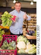 Купить «Happy customer buying radish at supermarket», фото № 32587997, снято 9 октября 2019 г. (c) Яков Филимонов / Фотобанк Лори