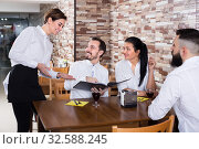 Woman waitress taking order from visitors. Стоковое фото, фотограф Яков Филимонов / Фотобанк Лори