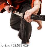 Man in traditional chinese in studio with a sword. Стоковое фото, фотограф Гурьянов Андрей / Фотобанк Лори