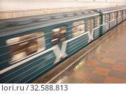 Купить «Движущийся вагон Московского метро», фото № 32588813, снято 7 декабря 2019 г. (c) Victoria Demidova / Фотобанк Лори