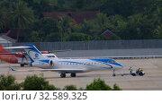 Купить «Private airplane towing in Phuket airport», видеоролик № 32589325, снято 27 ноября 2019 г. (c) Игорь Жоров / Фотобанк Лори