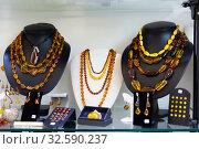 Купить «Natural amber jewelry in shop», фото № 32590237, снято 25 февраля 2020 г. (c) Яков Филимонов / Фотобанк Лори