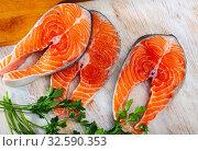 Купить «Raw salmon fillet on wooden table», фото № 32590353, снято 12 декабря 2019 г. (c) Яков Филимонов / Фотобанк Лори