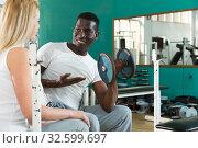 Купить «Couple talking at sport club», фото № 32599697, снято 25 февраля 2019 г. (c) Яков Филимонов / Фотобанк Лори