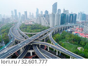 Купить «Aerial view of city interchange in shanghai, elevated road junction closeup», фото № 32601777, снято 7 июня 2020 г. (c) easy Fotostock / Фотобанк Лори
