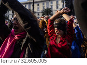 Flash Mob 'A Violador En Tu Camino', launched by the Chilean feminist collective Lastesis and organized by Non Una di Meno (Not One Less), Cavour Square, Rome, Italy 07-12-2019. Редакционное фото, фотограф Serrano / AGF/Alessandro SerranoÕ / age Fotostock / Фотобанк Лори