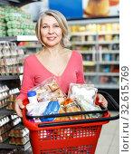 Woman holding basket of groceries. Стоковое фото, фотограф Яков Филимонов / Фотобанк Лори
