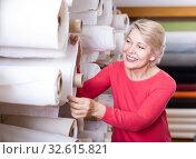 Купить «Blonde woman choosing interesting fabric», фото № 32615821, снято 15 февраля 2017 г. (c) Яков Филимонов / Фотобанк Лори
