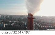 Купить «Air pollution problem - an industrial pipe pollutes the air in the city», видеоролик № 32617197, снято 21 февраля 2020 г. (c) Константин Шишкин / Фотобанк Лори