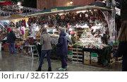 Купить «BARCELONA, SPAIN - DECEMBER 11, 2019:  Fair of  Santa Llucia - Christmas market near Cathedral   in evening. Barcelona, Catalonia.», видеоролик № 32617225, снято 11 декабря 2019 г. (c) Яков Филимонов / Фотобанк Лори