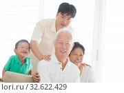 Купить «Portrait of happy Asian family at home, multi generations people indoor lifestyle.», фото № 32622429, снято 14 декабря 2019 г. (c) easy Fotostock / Фотобанк Лори