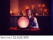 man fortune teller with illuminated crystal ball. Стоковое фото, фотограф Майя Крученкова / Фотобанк Лори